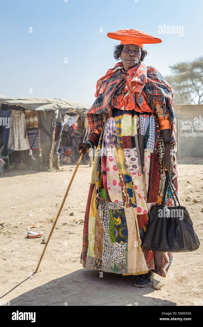 Herero woman dressed with a traditional attire, Opuwo, Namibia, Africa - Stock Image