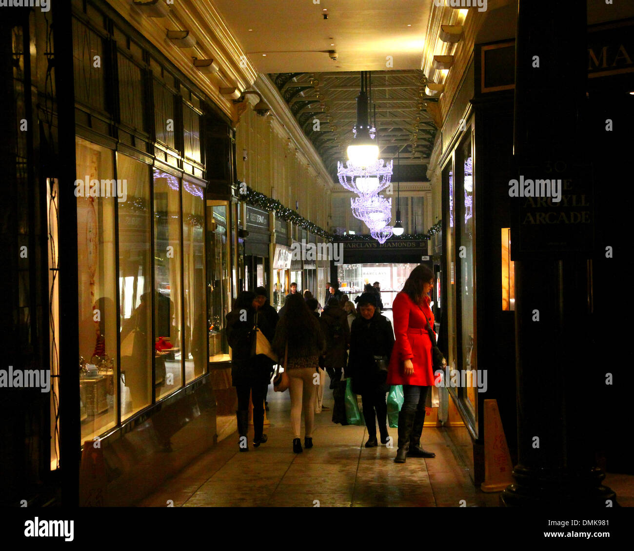 UK Weather 14 December.  Glasgow UK, Christmas shoppers sheltering from the rain and stormy winds in the Argyll Arcade. - Stock Image