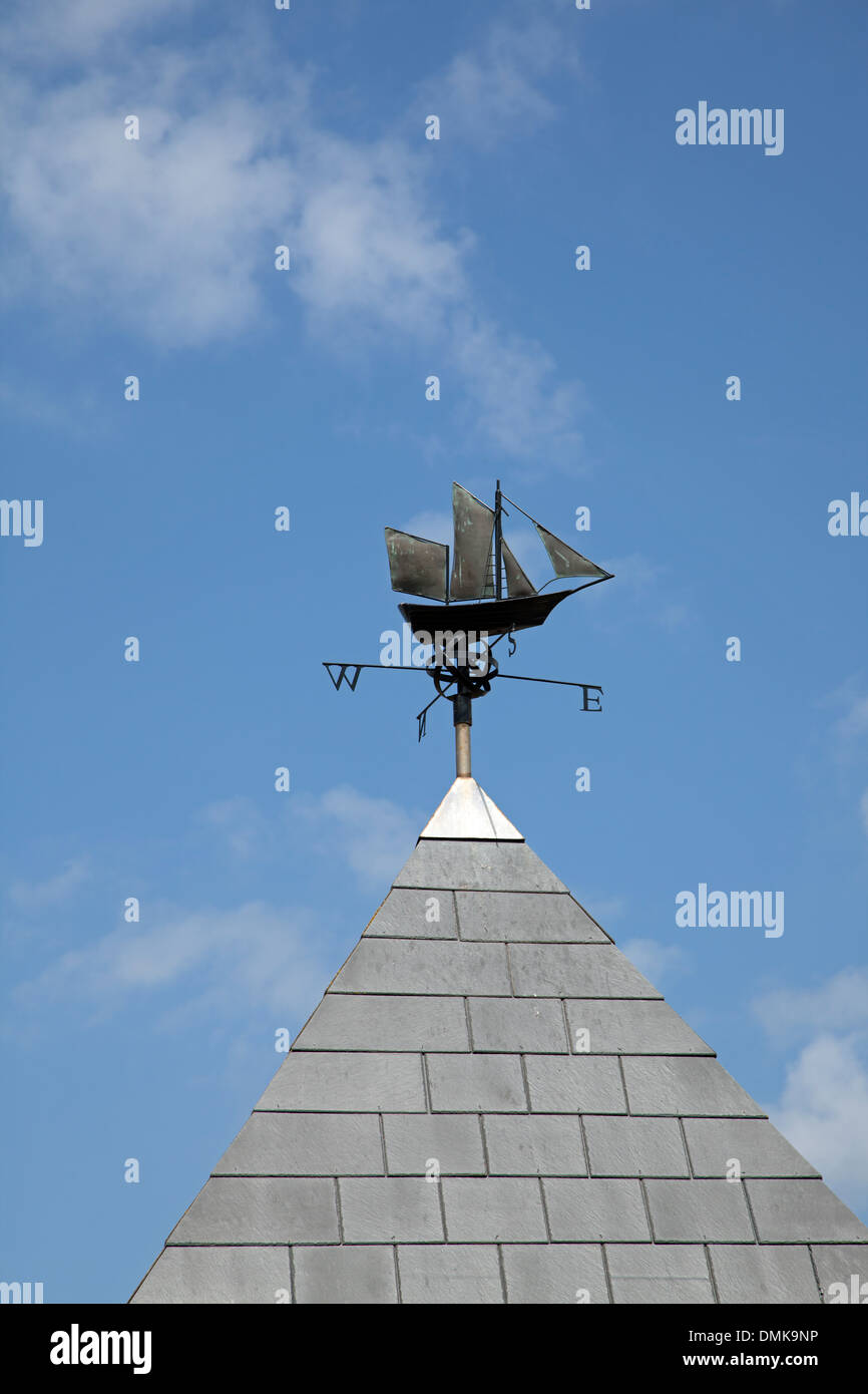 A ship weather vane atop a building at Burnham-on-sea, England - Stock Image