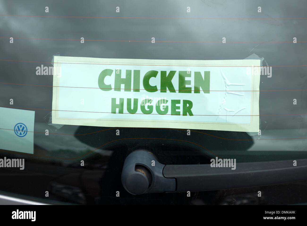 Chicken Hugger funny Sign Love animals anti cruelty - Stock Image