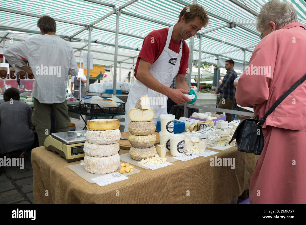 Artisan cheese maker for sale farmers market - Stock Image