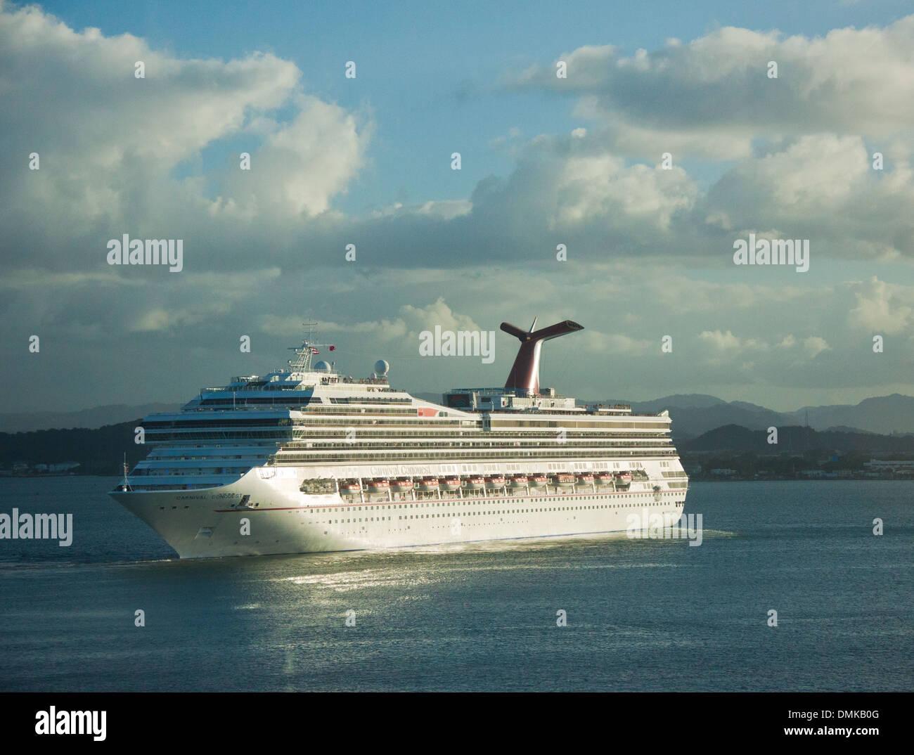 Carnival Conquest cruise ship entering port at San Juan, Puerto Rico Stock Photo