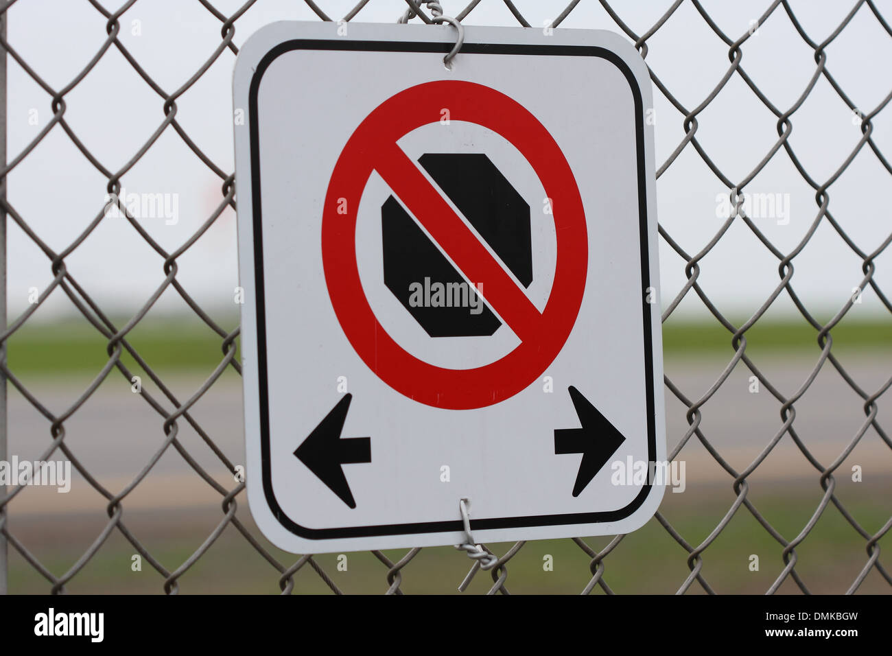 No Stopping road sign on the chicken wire fence, June 26, 2013 - Stock Image