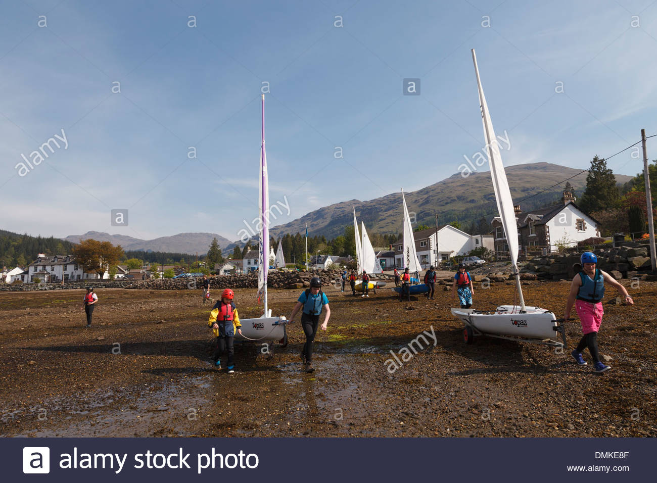 Group of children preparing to go sailing at Lochgoilhead Stock Photo