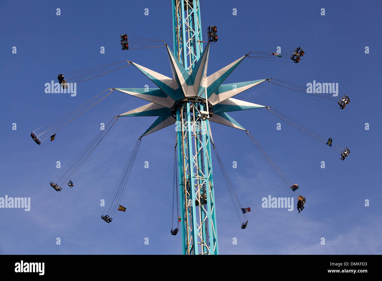 suspended chairs Carousel high in the sky Fairground Ride - Stock Image
