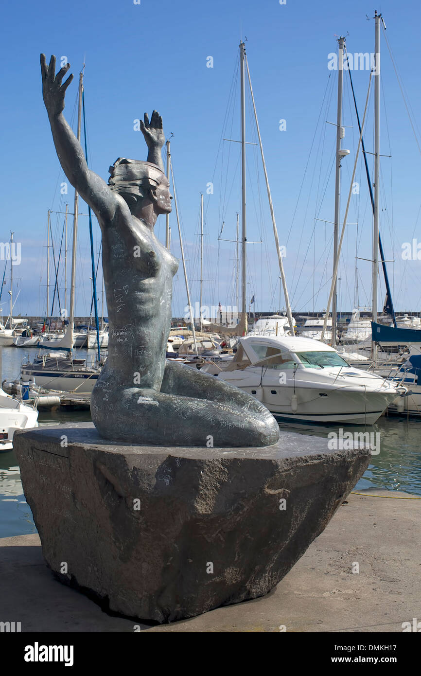 Sculpture mermaid desecrated inscriptions port of Funchal, Madeira. - Stock Image