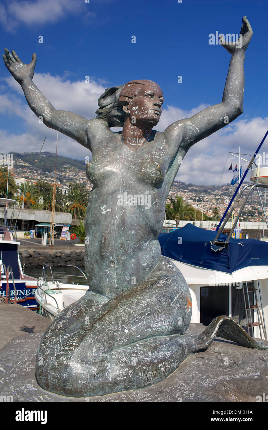 Sculpture mermaid desecrated inscriptions in Funchal, Madeira. - Stock Image