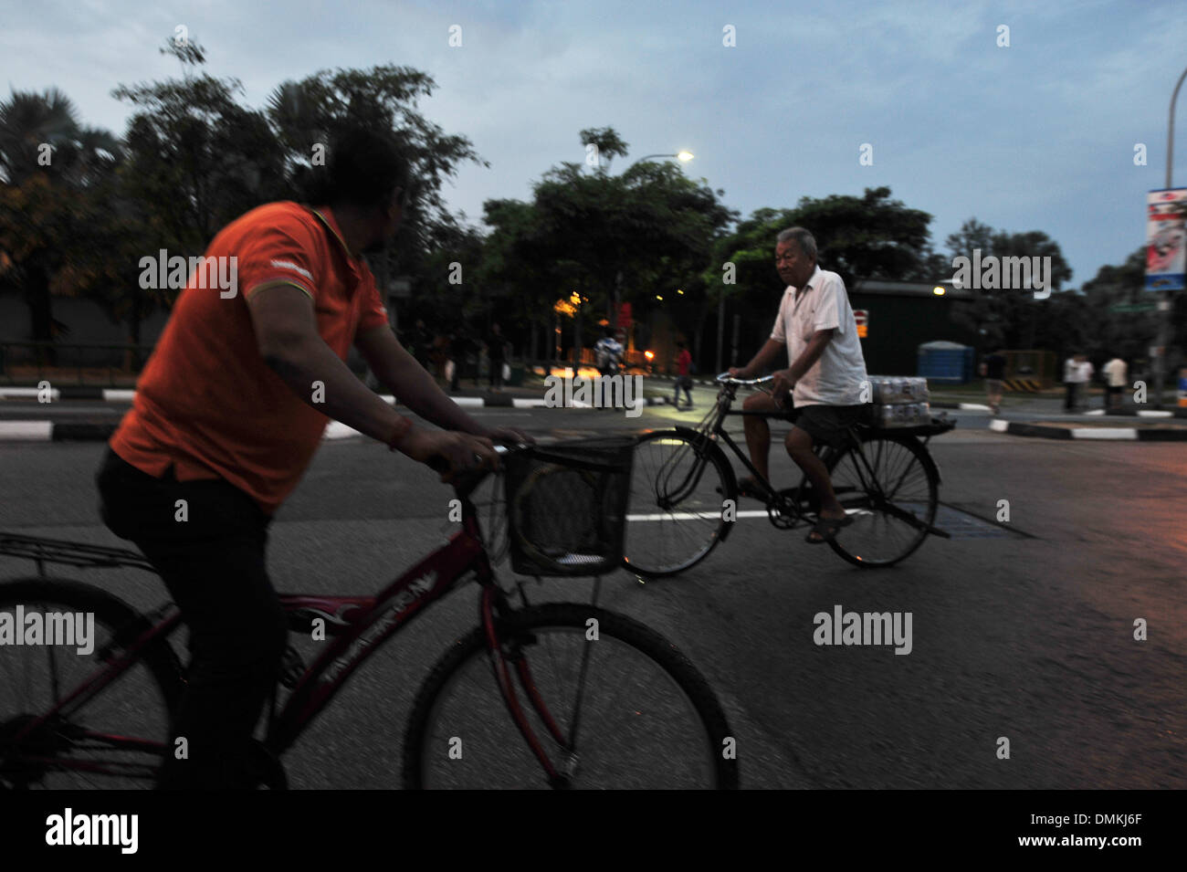 Singapore. 15th Dec, 2013. Two city dwellers cycle along Singapore's Race Course Rd, Dec. 15, 2015. Singapore government has suspended the sale and consumption of alcoholic drinks in Little India area from Dec. 14 to 15. Credit:  Then Chih Wey/Xinhua/Alamy Live News - Stock Image