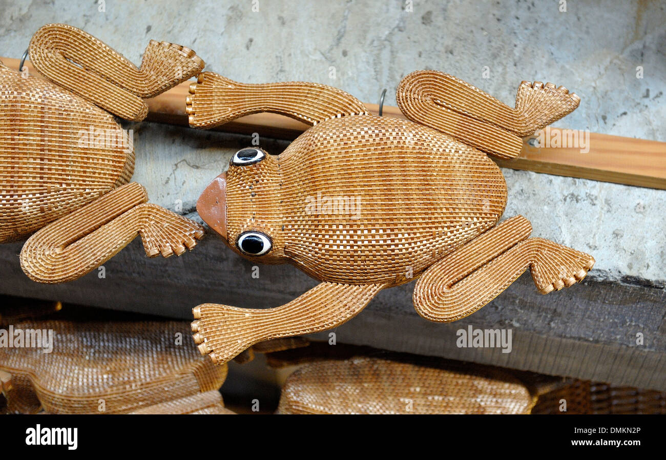 Madeira Portugal. Wicker frog souvenirs in a wicker factory shop in Camacha - Stock Image