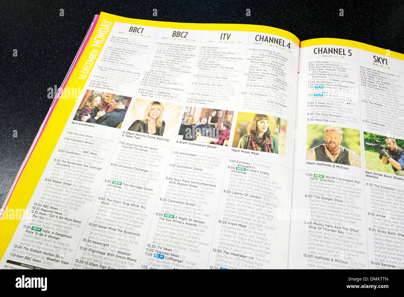 UK TV listings television programs listed by channel channels in paper book form - Stock Image