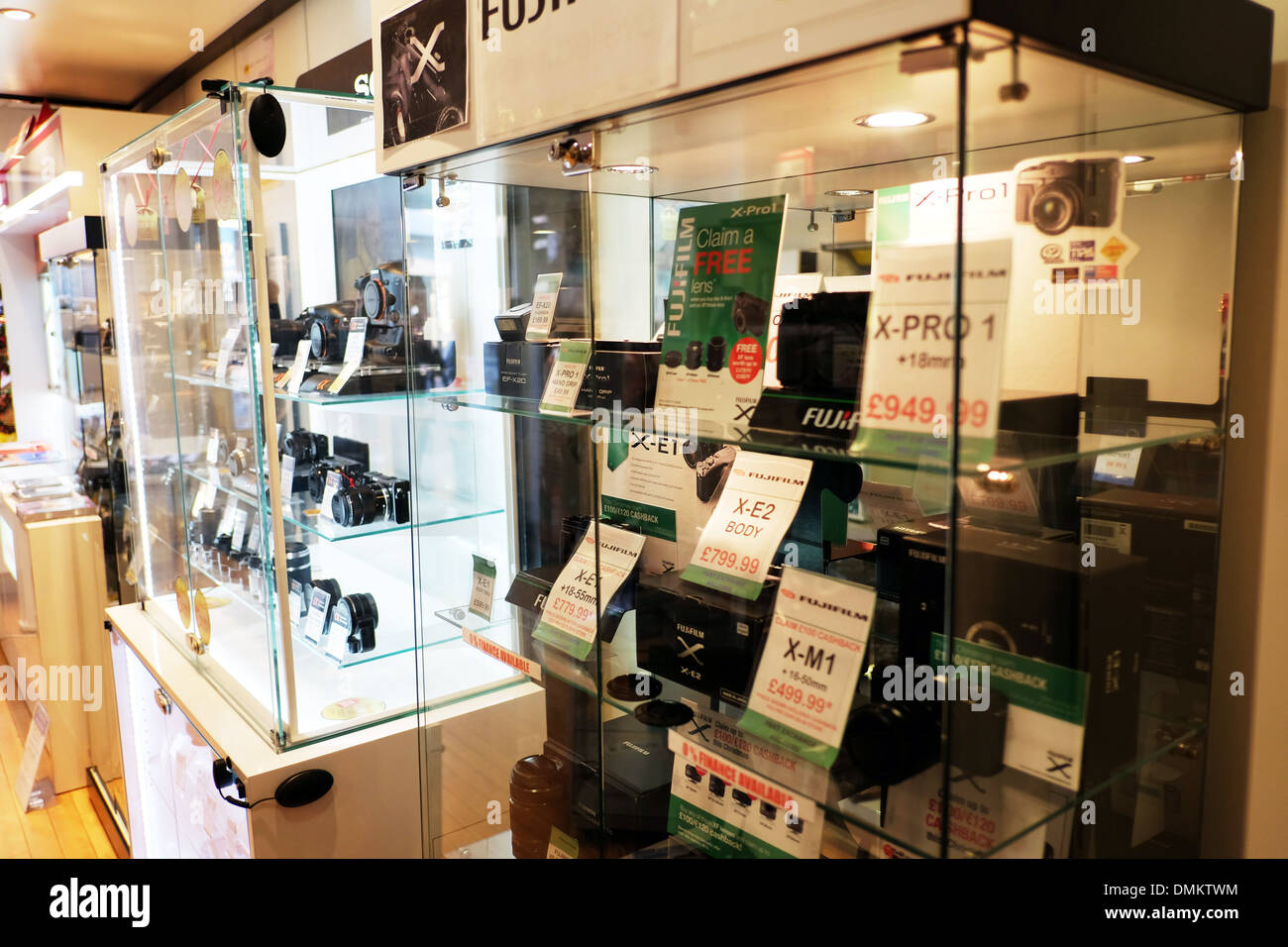 Fuji x-pro 1 camera display cabinet in shop new cameras for sale in glass case cabinet lens lenses displayed - Stock Image