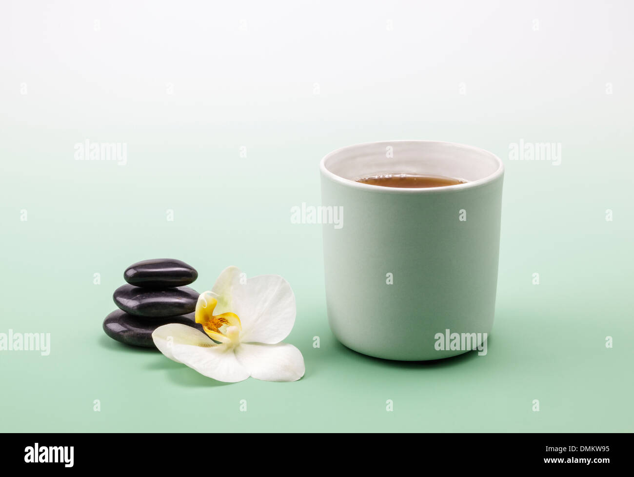 A cup of relaxing herb tea - Stock Image