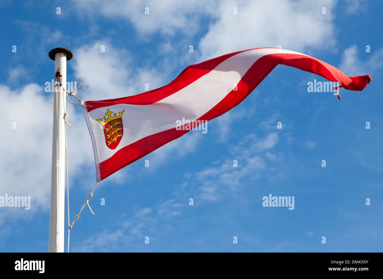 Jersey coat of arms on flag, Channel Islands, UK - Stock Image