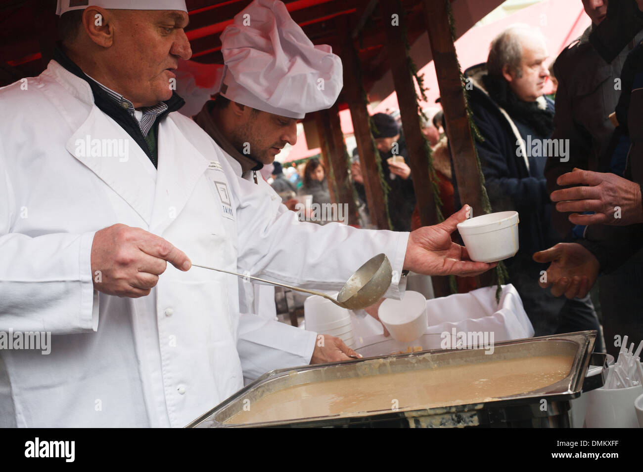 Mayor of Prague of that time Bohuslav Svoboda gives away free fish soup at Old Town Square in Prague, Czech Republic - Stock Image