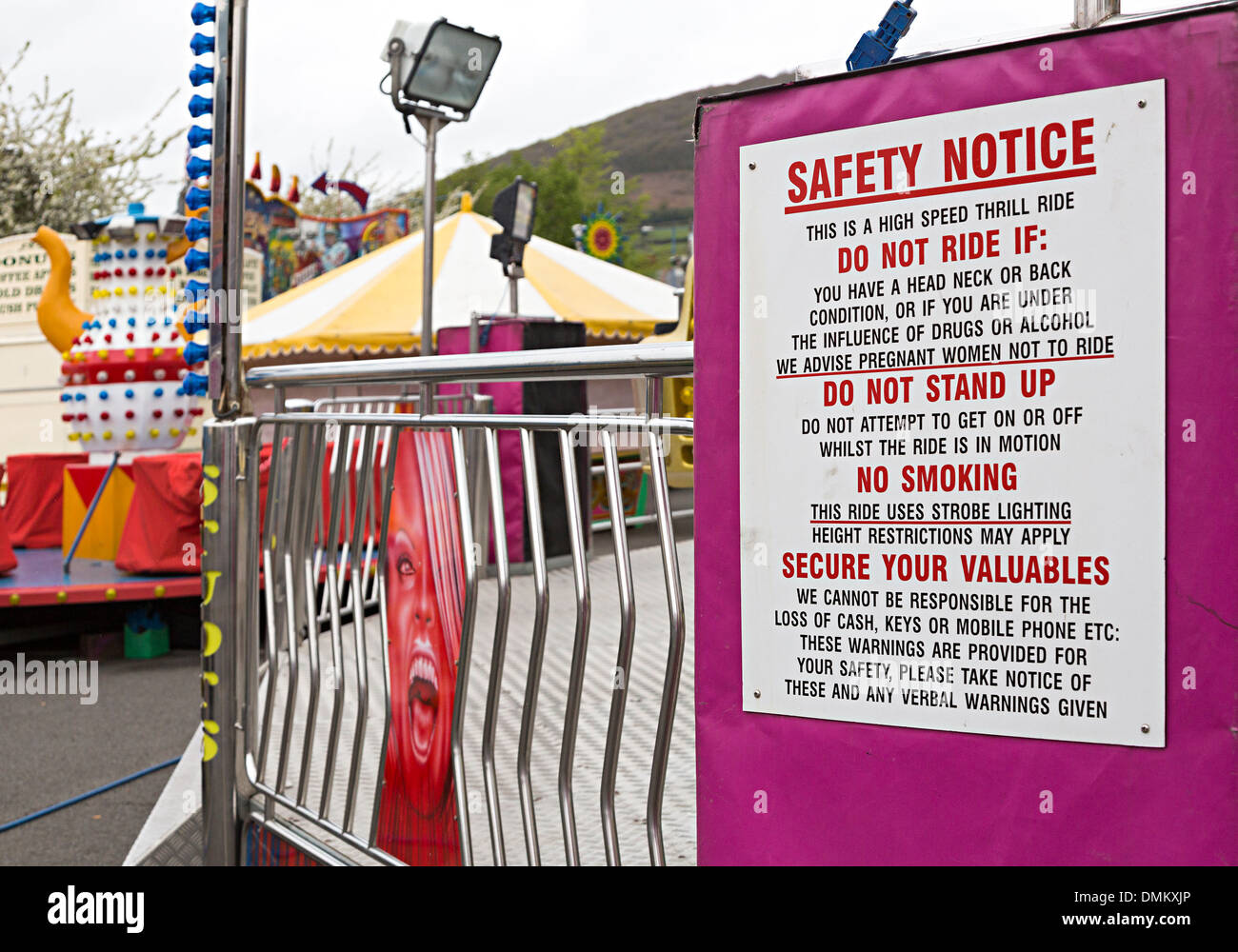 Warning medical sign on fairground thrill ride, UK - Stock Image