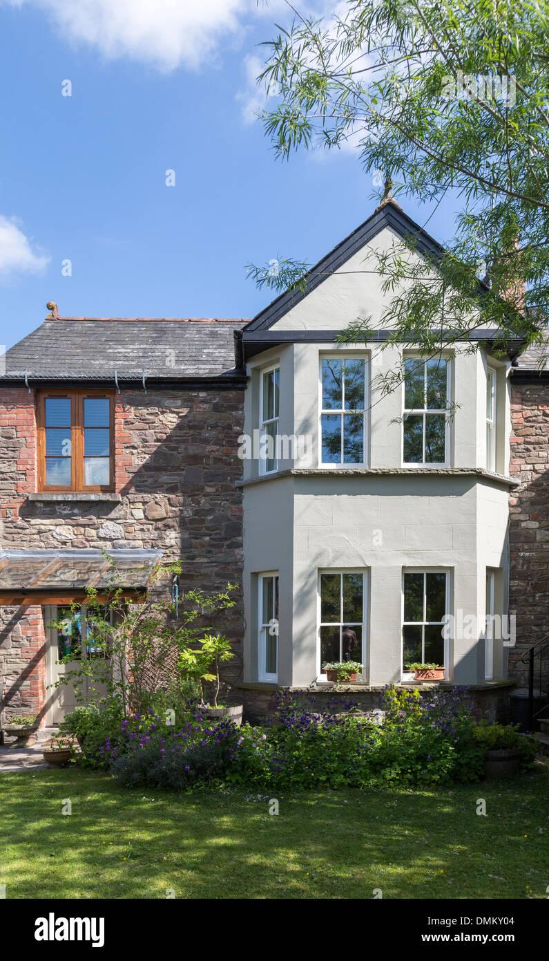 Bay windows on stone built house, Wales, UK - Stock Image