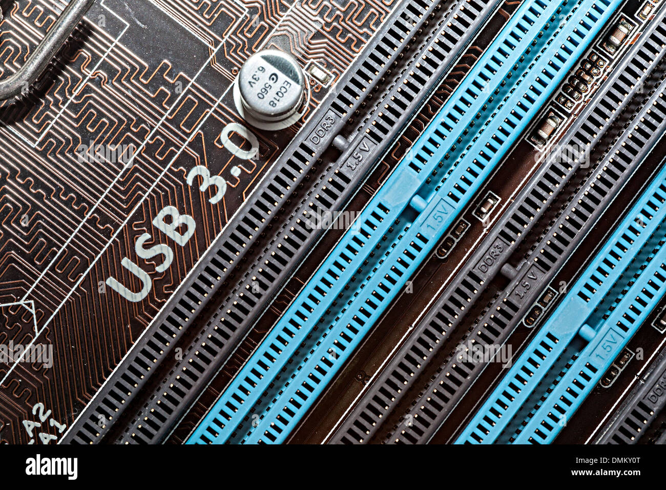 Computer motherboard with USB 3.0 written near slots for memory chips - Stock Image