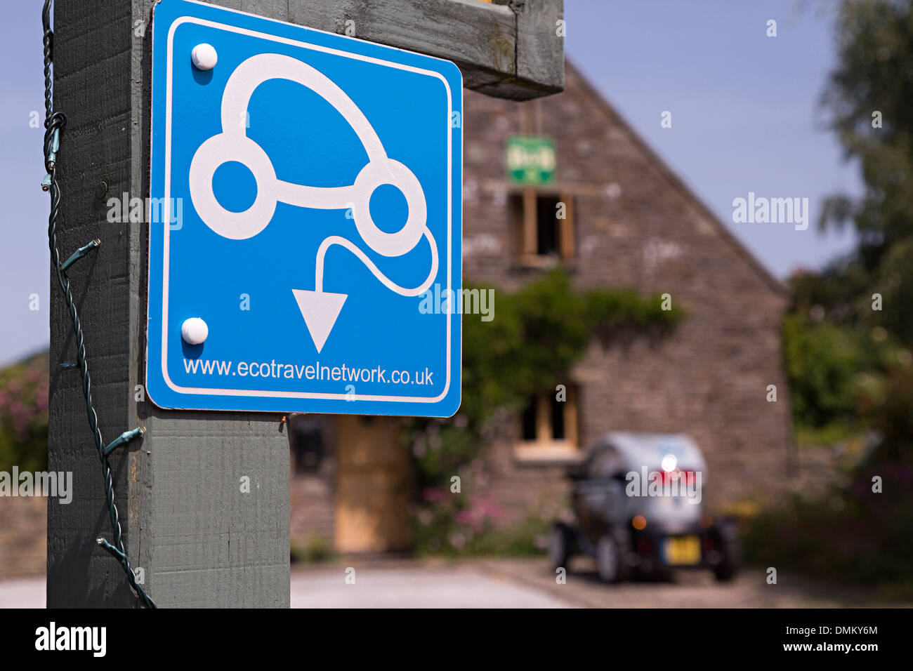 Eco travel network sign with ecological car in background, Talgarth, Wales, UK - Stock Image