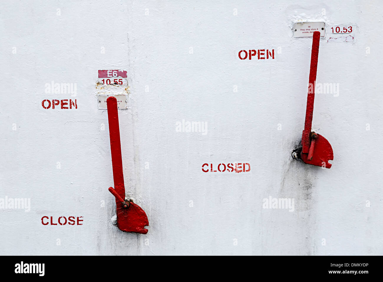 Levers with open and closed signs on ferry UK - Stock Image
