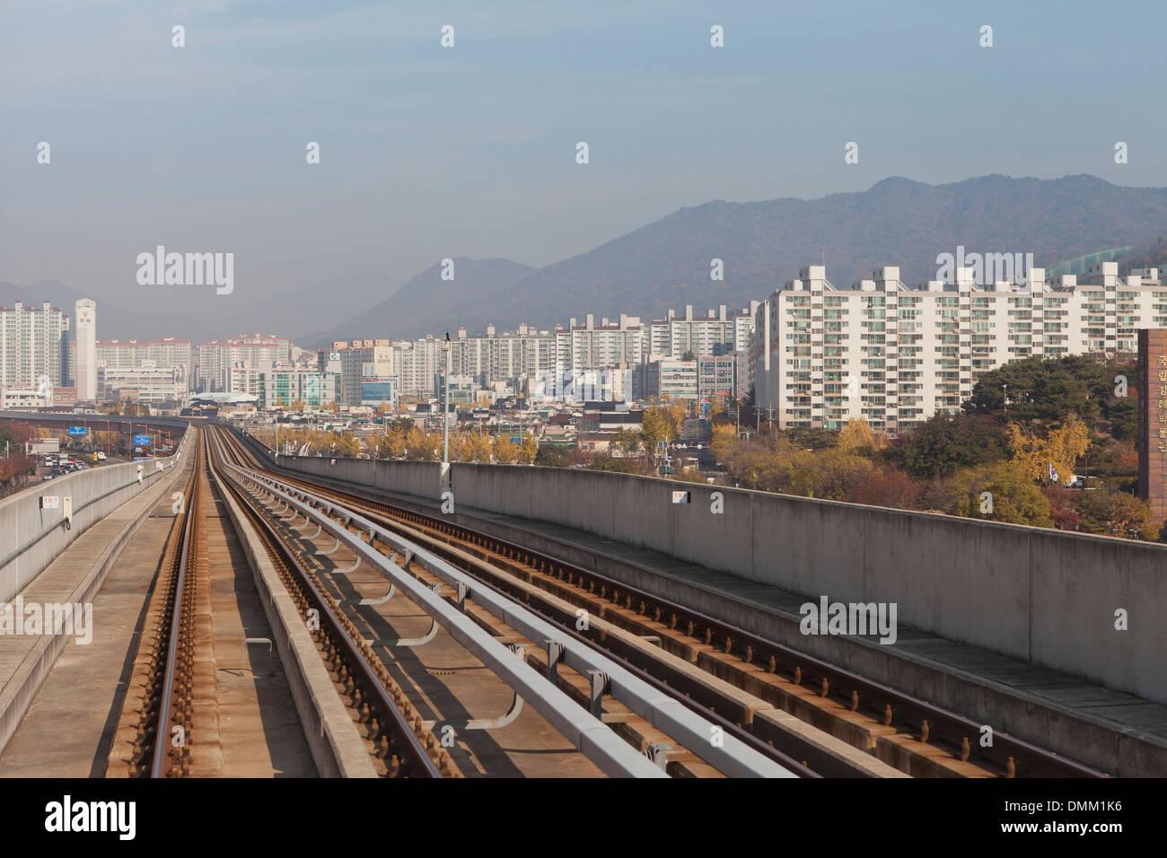Busanu2013Gimhae Light Rail Transit train tracks - South Korea & Busanu2013Gimhae Light Rail Transit train tracks - South Korea Stock ...