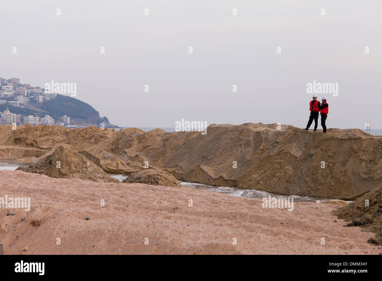 Supervisors overlooking a beach reclamation project site - Haeundae, Busan, South Korea - Stock Image