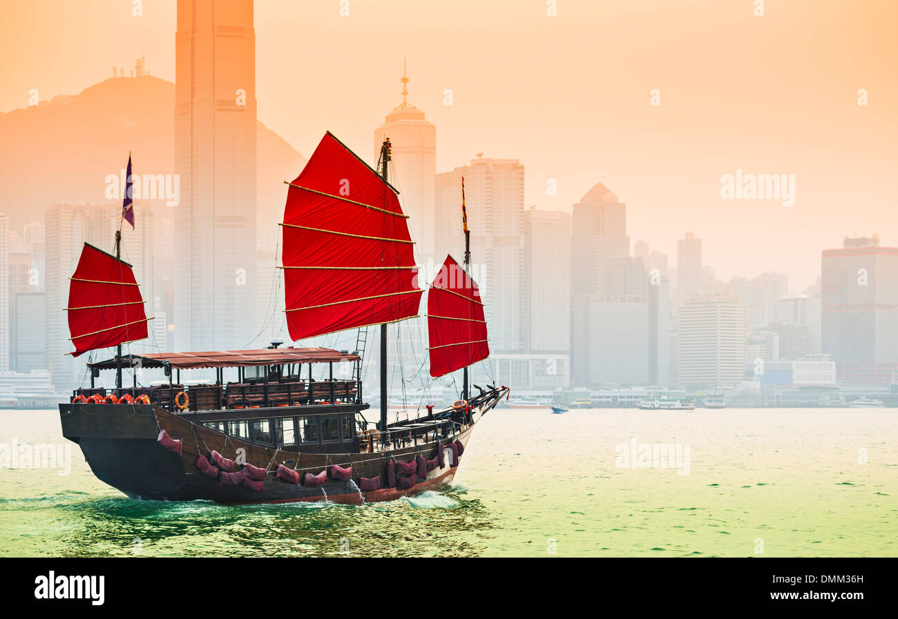 Junk Ship sails in Victoria Harbor in Hong Kong, China. - Stock Image