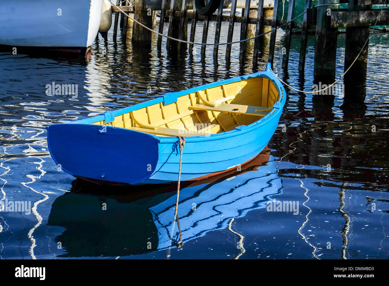 A blue painted traditional wooden dinghy moored at the Wooden Boat School at Franklin in Tasmania - Stock Image