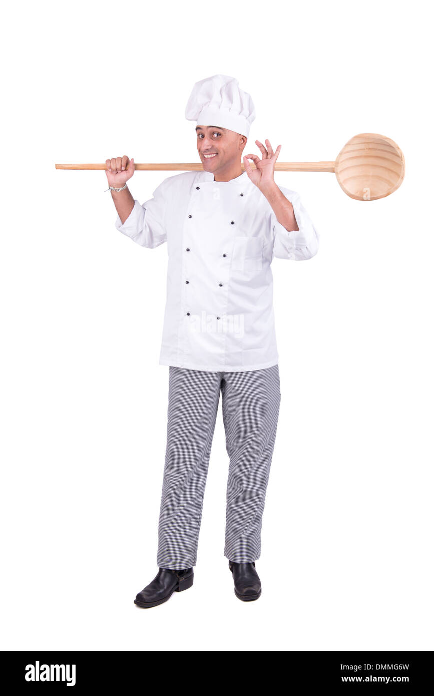Male chef posing with huge wooden spoon isolated on white background - Stock Image