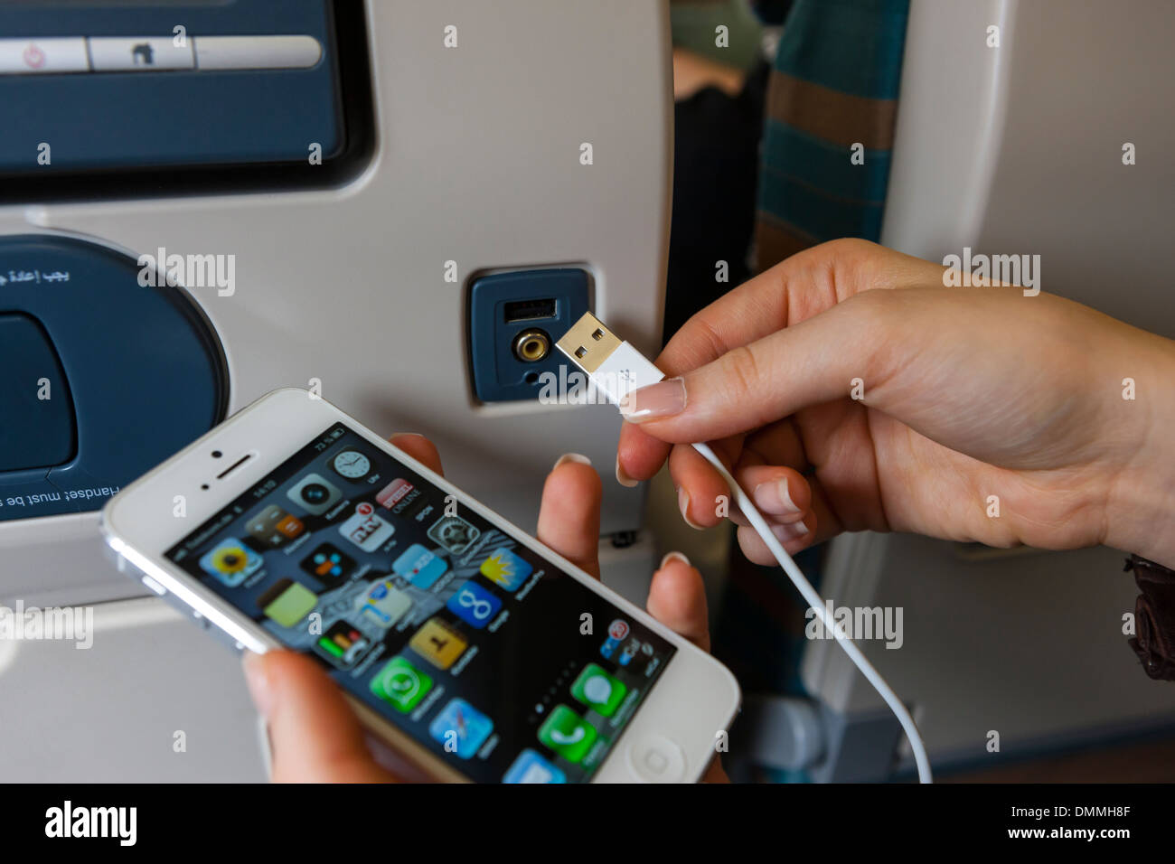 Smart phone and USB socket in airplane seat - Stock Image