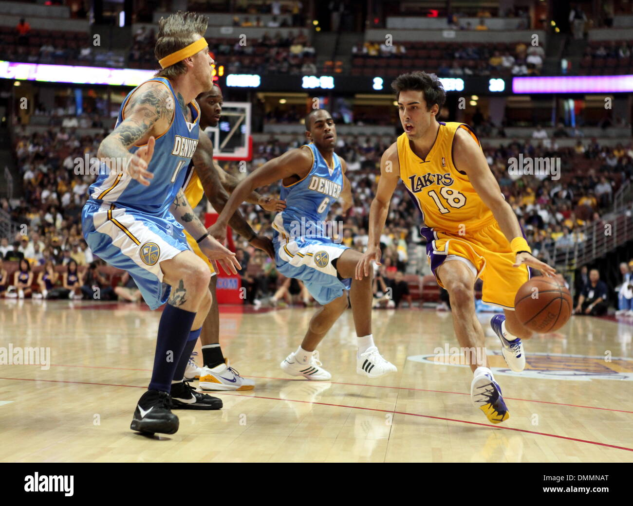 6b8156b30 ... USA - Los Angeles Lakers  SASHA VUJACIC  18 drives the ball through the  defense of Denver Nuggets  CHRIS ANDERSEN  11 during a preseason game at  the ...