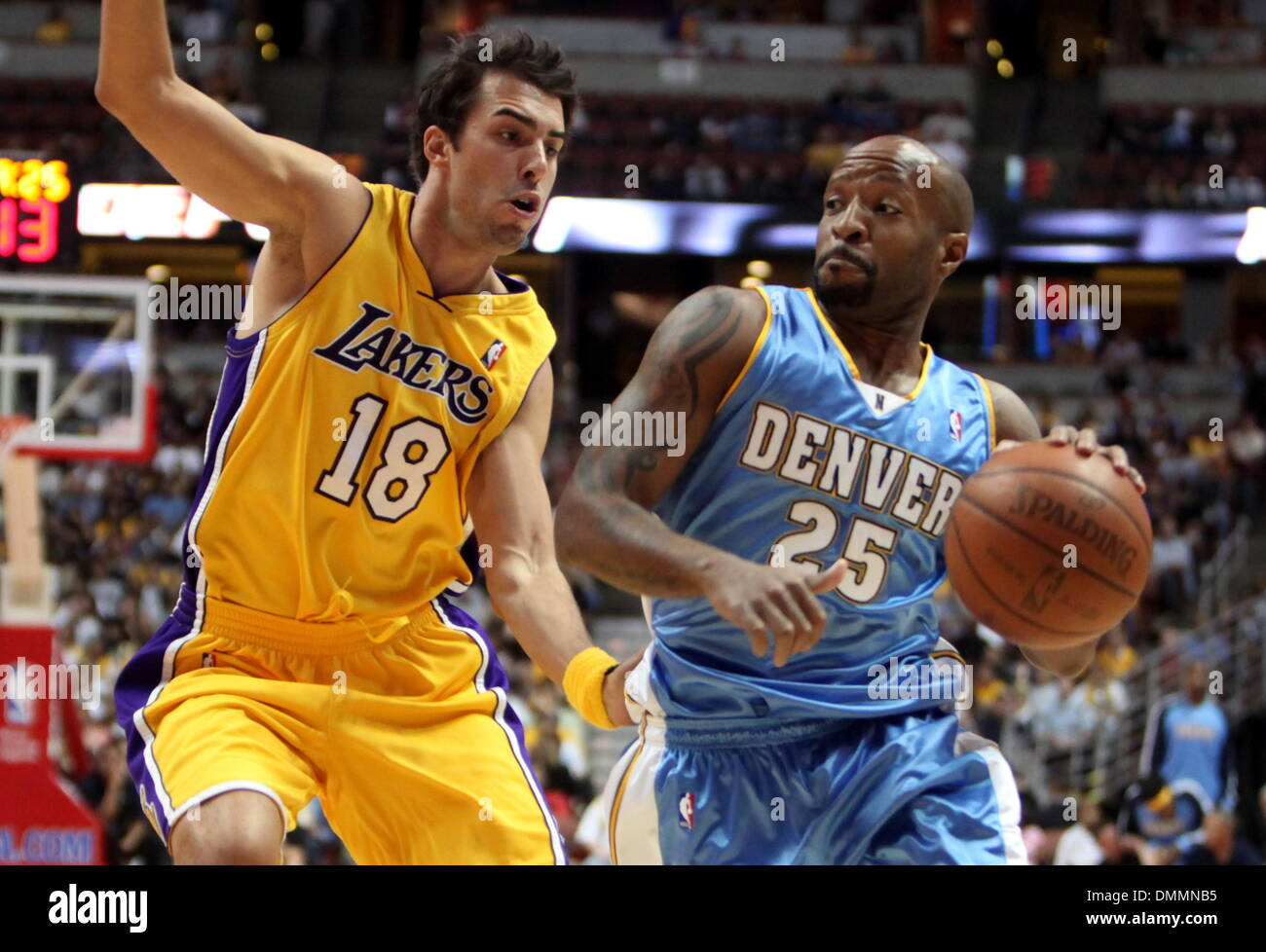 3b1ae2eff ... USA - Denver Nuggets  ANTHONY CARTER  25 drives the ball pass Los  Angeles Lakers  SASHA VUJACIC  18 during a preseason game at the Honda  Center. Lakers ...