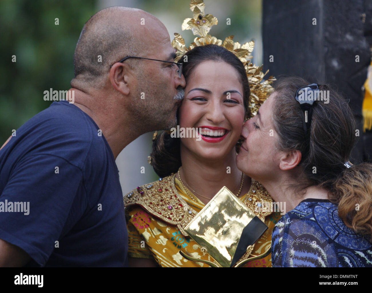 Nov 08, 2009 - Nusa Dua, Bali, Indonesia - French player ARAVANE REZAI (middle) with her father Arsalan (right) and mother Nouchine (left) pose in Balinese traditional costume with her trophy during photo session after final match of tennis tournament Commonwealth Bank WTA Tour 2009. Rezai become the champion by score 7-5 in first set after Bartoli call retire due to her leg injur. - Stock Image