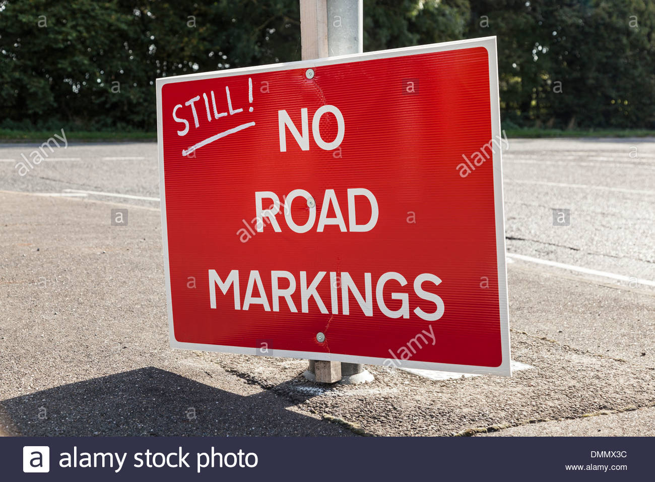 Defaced road sign - Still No Road Markings - Stock Image