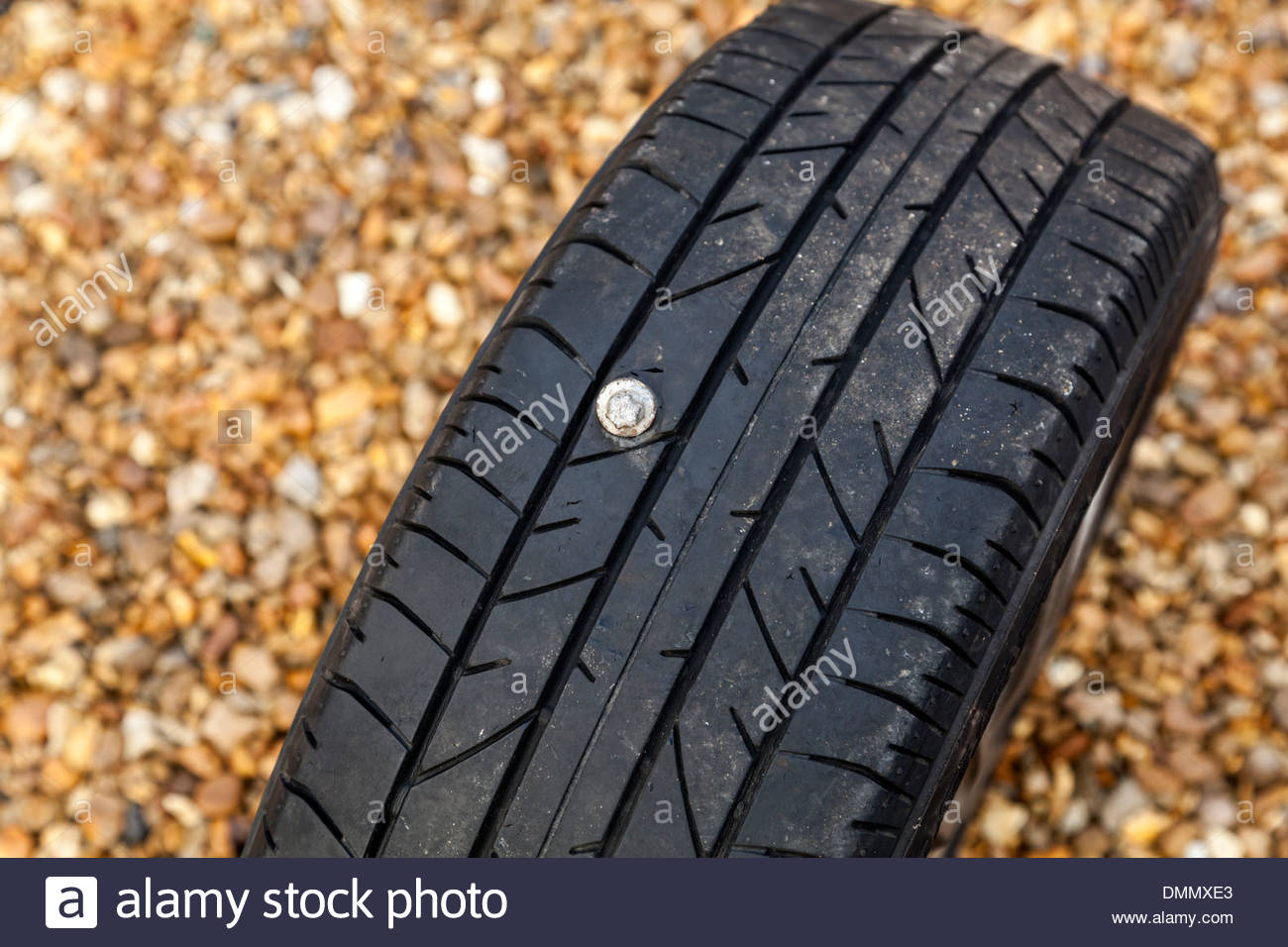 Tyre puncture - nail in tyre Stock Photo: 64384043 - Alamy