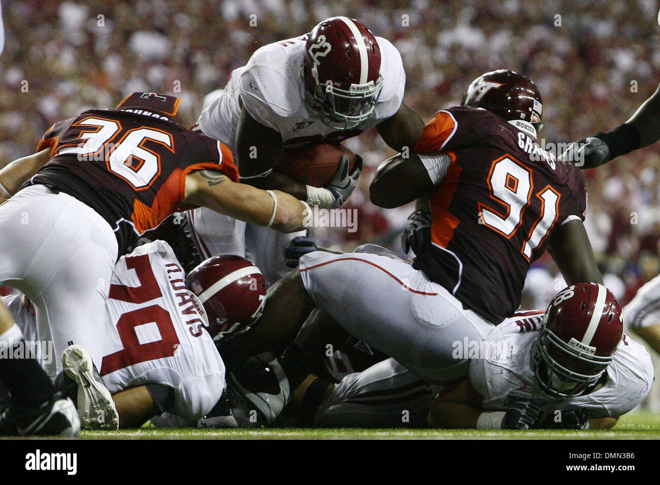 Sep 05, 2009 - Atlanta, Georgia, USA - NCAA Football - Alabama's MARK INGRAM (22) dives over Virginia Tech's JOHN GRAVES (91) and JAKE JOHNSON (36) during the second half of their season opener in the Georgia Dome (Credit Image: © Josh D. Weiss/ZUMA Press) - Stock Image