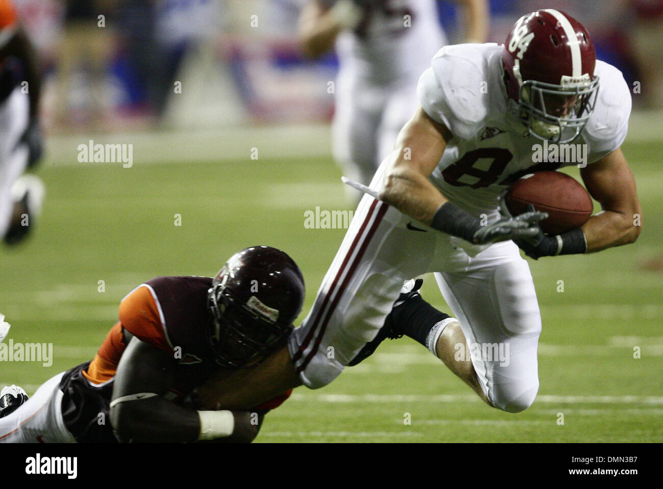 Sep 05, 2009 - Atlanta, Georgia, USA - NCAA Football - Alabama's COLIN PEEK (84) gets tripped up by Virginia Tech's KAM CHANCELLOR, left, during the second half of the schools' season opener in the Georgia Dome. (Credit Image: © Josh D. Weiss/ZUMA Press) - Stock Image