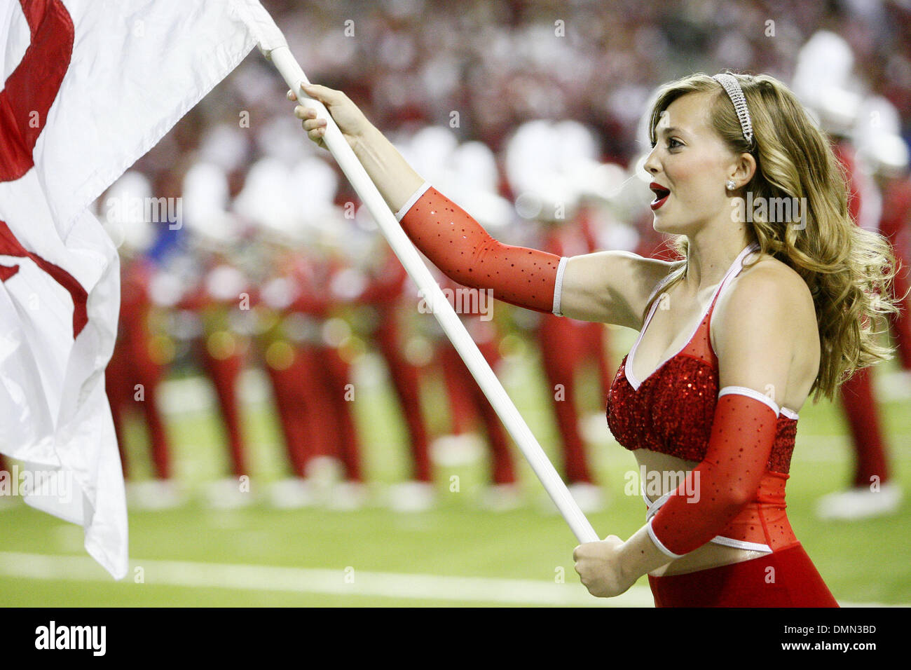 Sep 05, 2009 - Atlanta, Georgia, USA - NCAA Football - A University of Alabama flag girl waves her flag before the start of Alabama's season opener against Virginia Tech in the Georgia Dome. (Credit Image: © Josh D. Weiss/ZUMA Press) - Stock Image