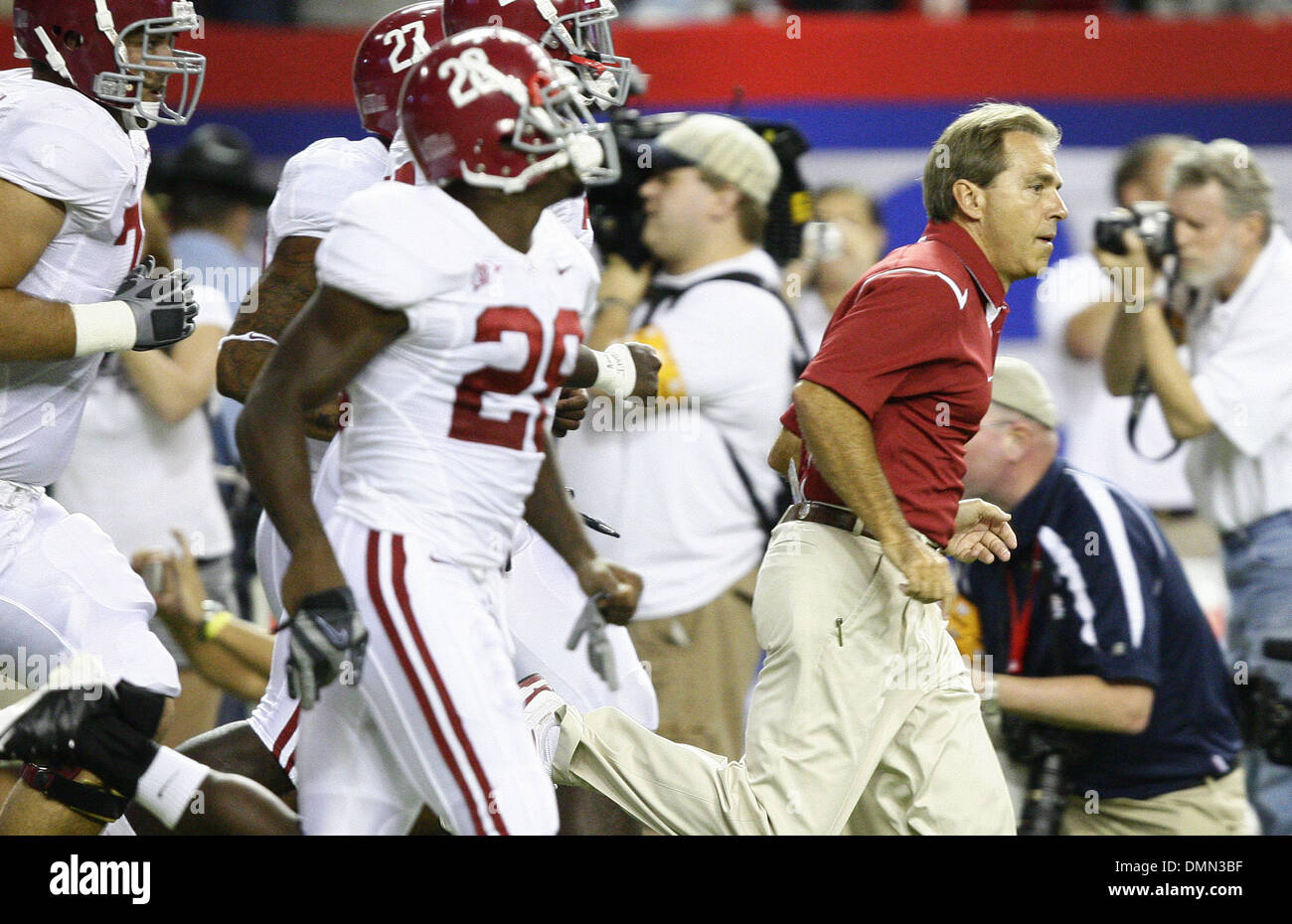 Sep 05, 2009 - Atlanta, Georgia, USA - NCAA Football - Alabama Head Coach NICK SABAN runs out onto the field with his players before their season opener against Virginia Tech in the Georgia Dome. (Credit Image: © Josh D. Weiss/ZUMA Press) - Stock Image