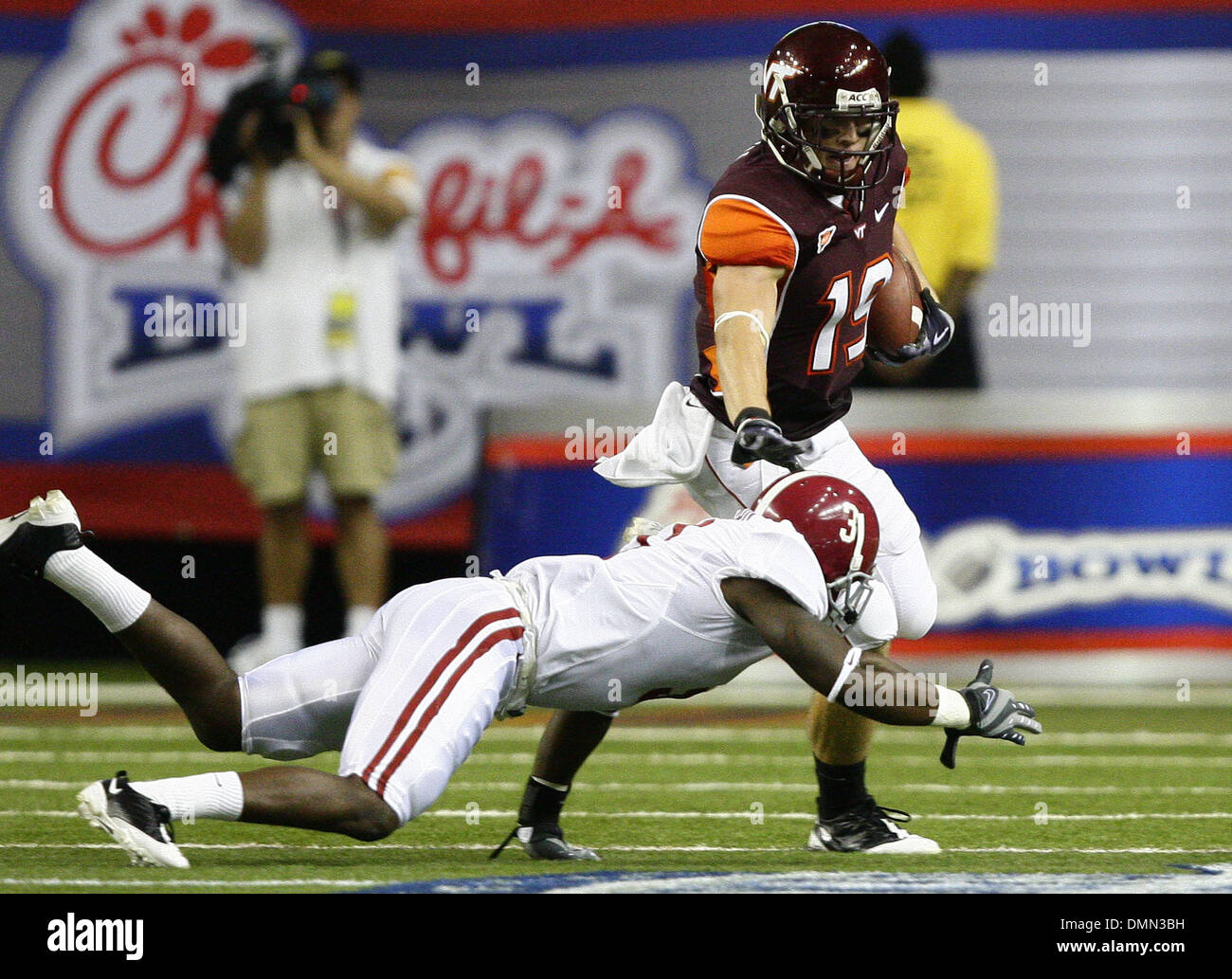 Sep 05, 2009 - Atlanta, Georgia, USA - NCAA Football - Virginia Tech's DANNY COALE (19) prepares to stiff arm Alabama's KAREEM JACKSON (3) during the first half of their season opener in the Georgia Dome. (Credit Image: © Josh D. Weiss/ZUMA Press) - Stock Image