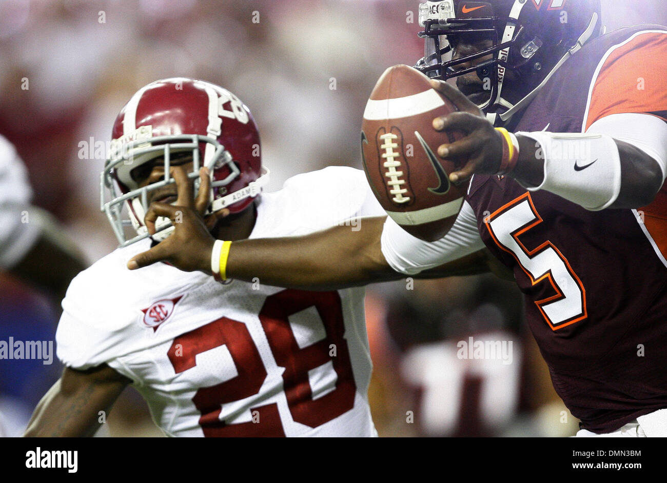 Sep 05, 2009 - Atlanta, Georgia, USA - NCAA Football - Virginia Tech's TYROD TAYLOR (5) stiff arms Alabama's JAVIER ARENAS (28) during the first half of the schools' season opener in the Georgia Dome. (Credit Image: © Josh D. Weiss/ZUMA Press) - Stock Image