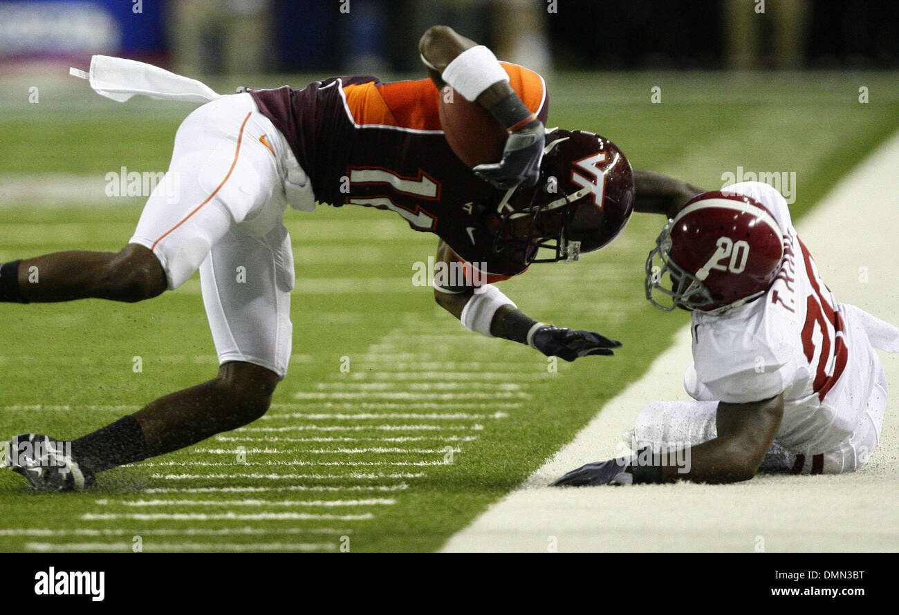 Sep 05, 2009 - Atlanta, Georgia, USA - NCAA Football - Alabama's TYRONE KING (20) draws a penalty for a horse collar tackle on Virginia Tech's DYRELL ROBERTS (11) during the first half of their game in the Georgia Dome (Credit Image: © Josh D. Weiss/ZUMA Press) - Stock Image