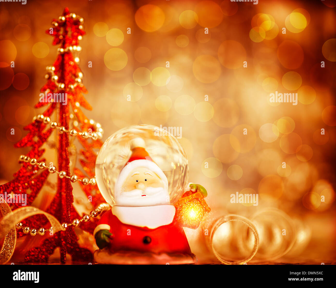 red christmas background with cute snow globe santa claus border over blur bokeh lights magic of christmas holidays - Santa Claus Red