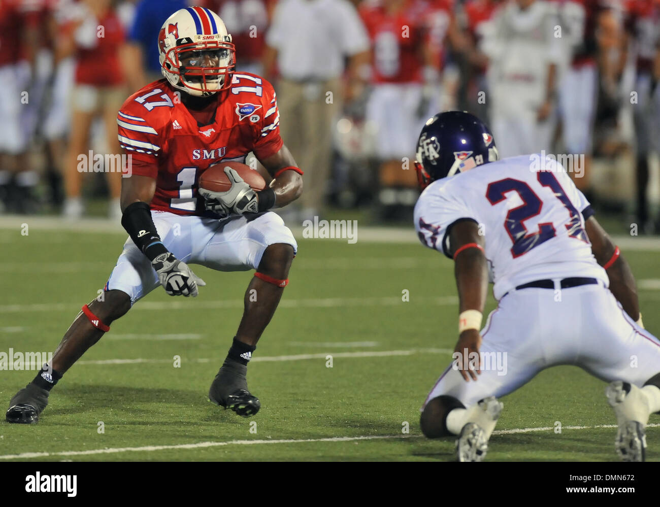 05 SEP 2009:  Stephen F Austin travels to Dallas to face the SMU Ponies in the season kickoff.  With a 4th quarter come back the Ponies win 31-23 over SFA.  SMU WR Emmanuel Sanders looks to side step DB Chad Haynes. (Credit Image: © Southcreek Global/ZUMApress.com) - Stock Image