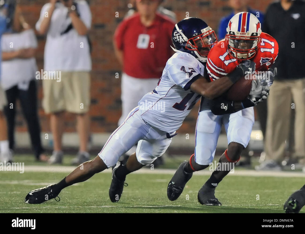 05 SEP 2009:  Stephen F Austin travels to Dallas to face the SMU Ponies in the season kickoff.  With a 4th quarter come back the Ponies win 31-23 over SFA.  Senior SMU WR Emmanuel Sanders gets tackled by DB Michael Williams. (Credit Image: © Southcreek Global/ZUMApress.com) - Stock Image