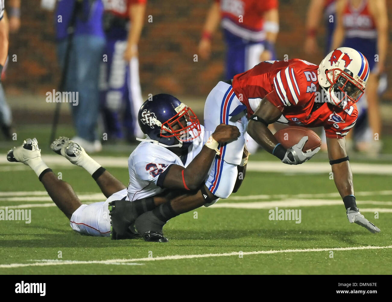 05 SEP 2009:  Stephen F Austin travels to Dallas to face the SMU Ponies in the season kickoff.  With a 4th quarter come back the Ponies win 31-23 over SFA.  SMU WR Aldrick Robinson gets tackled by DB Chad Haynes. (Credit Image: © Southcreek Global/ZUMApress.com) - Stock Image