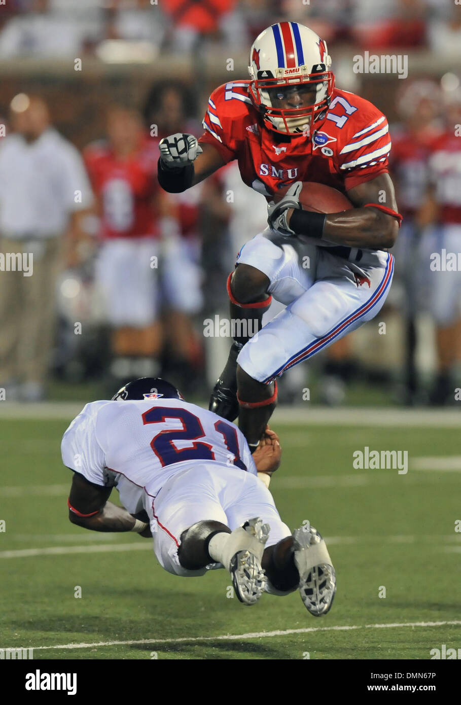 05 SEP 2009:  Stephen F Austin travels to Dallas to face the SMU Ponies in the season kickoff.  With a 4th quarter come back the Ponies win 31-23 over SFA.  SMU WR Emmanuel Sanders leaps over DB Chad Haynes. (Credit Image: © Southcreek Global/ZUMApress.com) - Stock Image