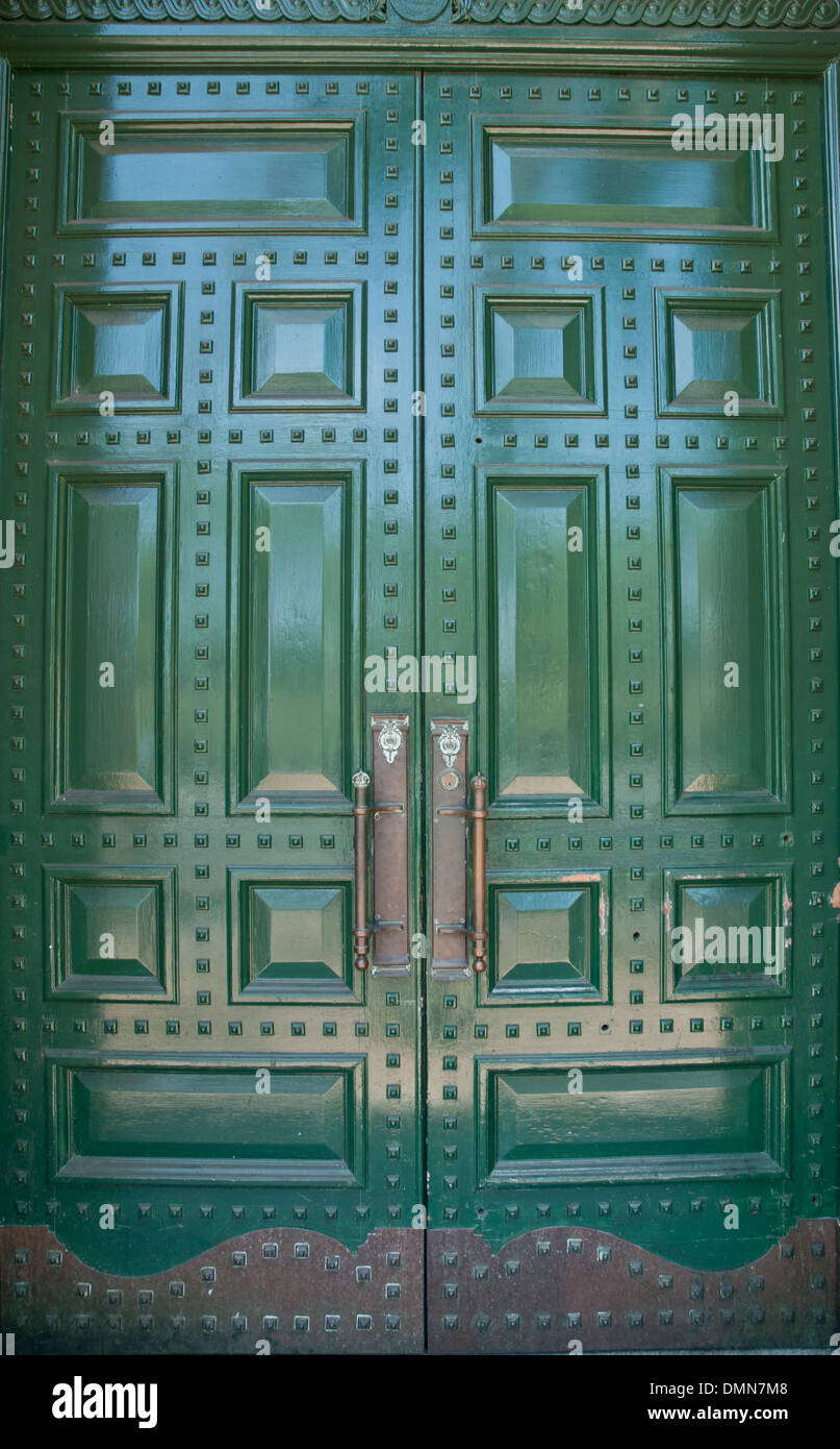 Big metallic green doors - Stock Image