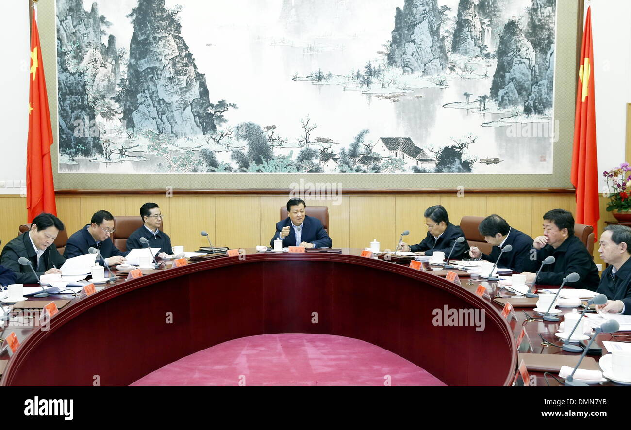 Beijing, China. 16th Dec, 2013. Liu Yunshan, a member of the Standing Committee of the Political Bureau of the Communist Party of China (CPC) Central Committee, presides over a meeting of the leading group of 'mass-line' campaign in Beijing, capital of China, Dec. 15, 2013. The one-year 'mass-line' campaign was launched in June to bridge gaps between CPC officials and members, and the general public, while cleaning up undesirable work styles such as formalism, bureaucracy, hedonism and extravagance. © Ju Peng/Xinhua/Alamy Live News - Stock Image
