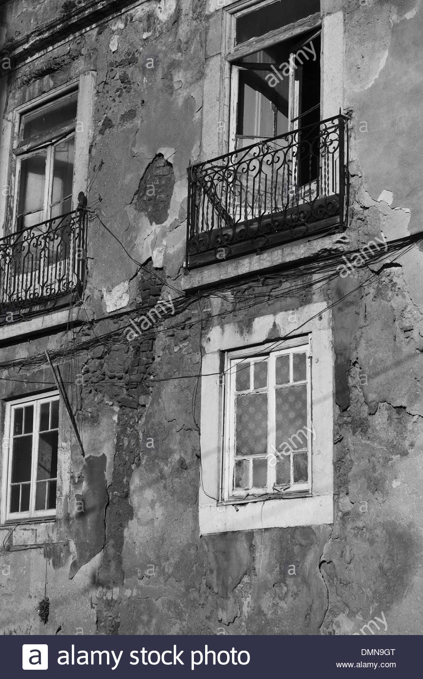 Black and white image of old house with balcony, Alfama, Lisbon, Portugal - Stock Image