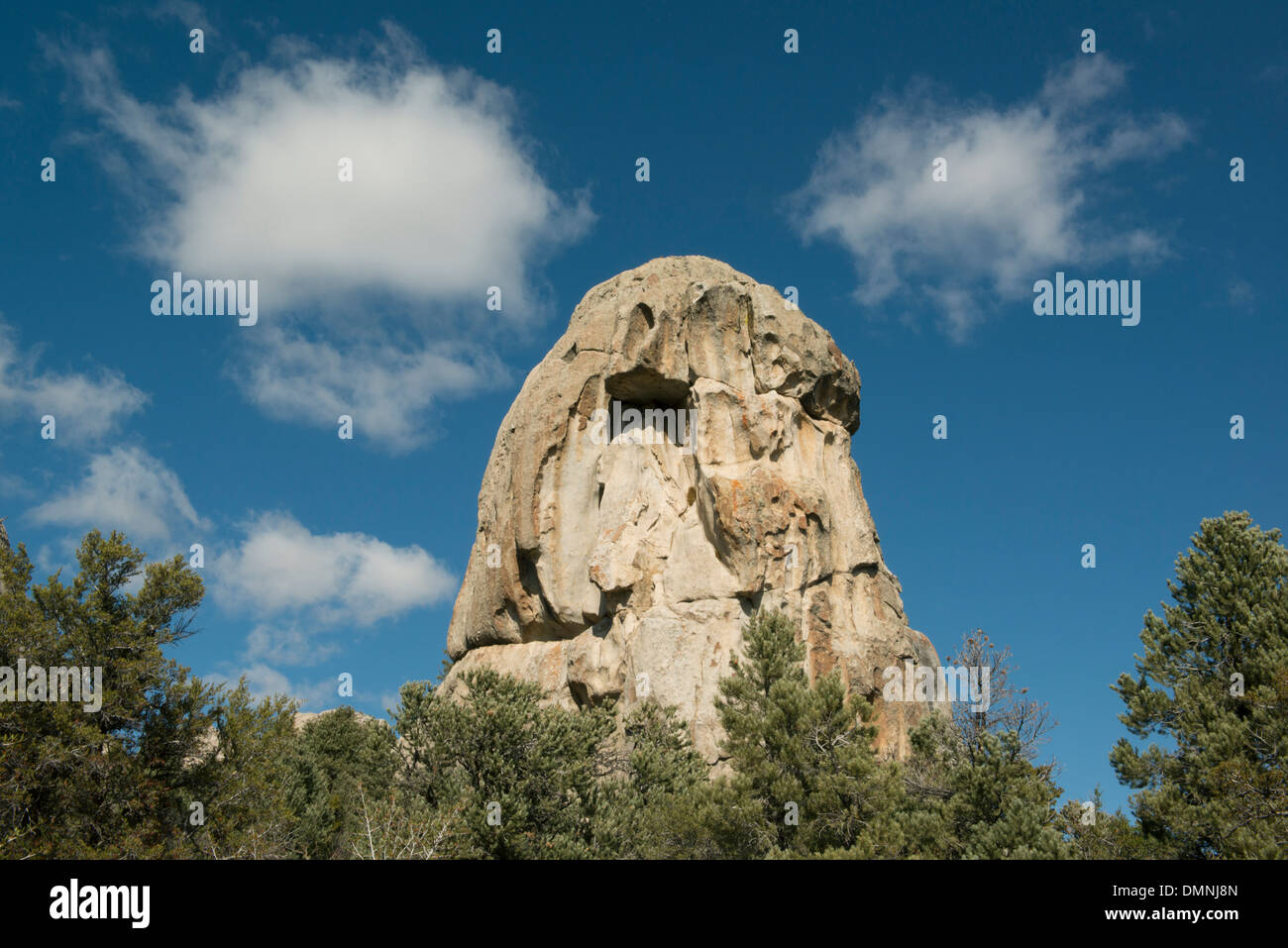 Granite Dome and Clouds, City of Rocks National Reserve, Southern Idaho - Stock Image